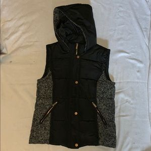 Black vest with white and black detailing